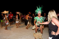 Young Polynesian Pacific Island Tahitian Men Dancers. AITUTAKI - SEP 18:Polynesian Pacific Island Tahitian male dancers in colorful costume dancing with tourists Stock Images