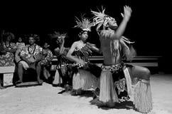 Young Polynesian Pacific Island Tahitian Men Dancers. Polynesian Pacific Island Tahitian male dancers in costume dancing on tropical beach. (BW Stock Photos