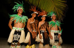 Young Polynesian Pacific Island Tahitian Men Dancers. Portrait of Polynesian Pacific Island Tahitian male dancers in colorful costume dancing on tropical beach Stock Photography
