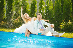 Young poolside Royalty Free Stock Photography