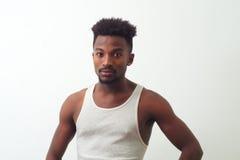 Young poor man undershirt white background studio shot Royalty Free Stock Images