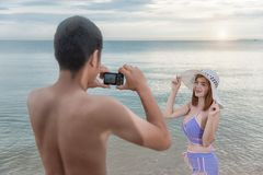 Young portrait couple having Beautiful woman posing for photogra Stock Photo