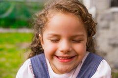 Young posing brunette girl closeup for camera Stock Photos