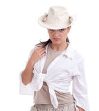 Young posing woman in white shirt and hat Stock Photography