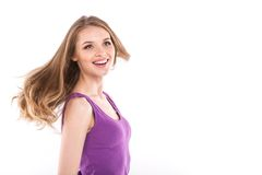 Young positive brunette girl with long hair loose on wind. Stock Image