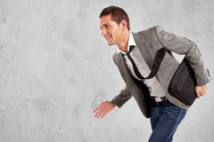 Young positive businessman walking. Grunge background Stock Photography