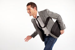 Young positive businessman walking. Isolated on white Stock Image