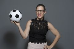 Young positive businesswoman - football fan holding soccer ball stock photography