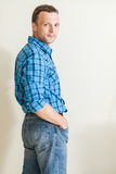 Young positive Caucasian man in blue shirt Royalty Free Stock Image