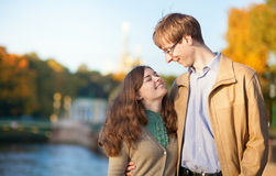 Young positive couple enjoying warm autumn day Stock Images