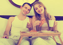 Young positive couple having healthy breakfast Royalty Free Stock Photo