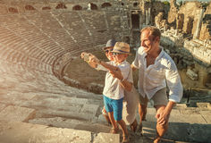 Young positive family take a self photo on the antique sights in Royalty Free Stock Photos