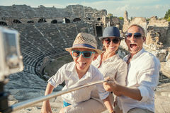 Young positive famly take a vacation photo on the Side ampitheat Royalty Free Stock Images