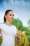 Young positive jogger in park Royalty Free Stock Image