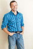 Young positive man in casual shirt, studio portrait Royalty Free Stock Photos