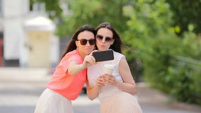 Young positive sisters having fun and making selfie. Concept of friendship and fun with new trends and technology. Best. Portrait of two young positive woman stock footage