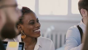 Young positive smiling professional African American corporate manager woman at team meeting, assistant brings coffee. stock video footage