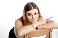 Young positive smiling student girl with notebook and pen planning her daily schedule wearing casual white t-shirt on white. Studi Stock Image