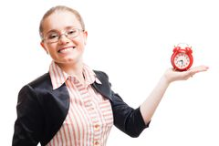 Young positive woman with alarm clock Royalty Free Stock Photography