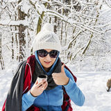 Young positive woman drinking hot tea in winter nature Stock Photo