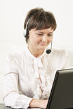 Young positive woman in headset Royalty Free Stock Photo
