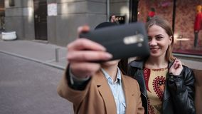 Young positive women making selfie with smartphone stock video