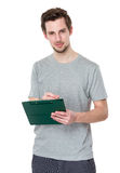 Young post employee taking notes Stock Photo