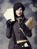 Young postman girl with mail. Royalty Free Stock Photos