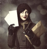 Young postman girl with mail. Photo in old color style with boke Stock Images