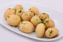 Young potatoes cooked whole deep-fried. royalty free stock image