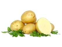 Young potatoes, decorating of parsley . Isolated Stock Images