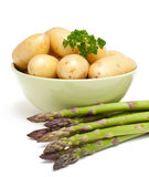 Young potatoes and green asparagus Stock Image
