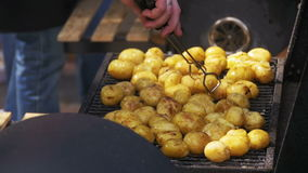 Young Potatoes Prepare on a Grill in Slow Motion stock video