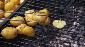 Young Potatoes Prepare on a Grill in Slow Motion stock video footage