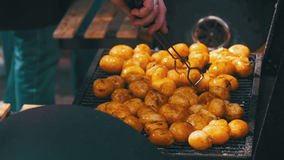 Young Potatoes Prepare on a Grill in Slow Motion stock footage