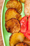 Young potatoes served on the plate with tomatoes Royalty Free Stock Photography