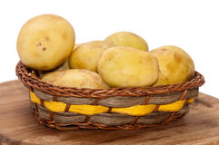 Young potatoes in a wicker basket Royalty Free Stock Image