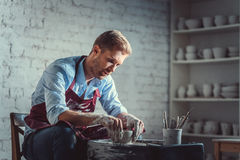 Young potter at work Royalty Free Stock Images