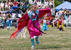 Young Powwow Fancy Shawl Dancer. Ohsweken, Ontario, Canada, July 27, 2008. A young Shawl Dancer performs during the Grand River Champion of Champions Powwow. The royalty free stock photo