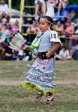 Young Powwow Jingle Dress Dancer. Ohsweken, Ontario, Canada, July 27, 2008. A young Jingle Dress Dancer performs during the Grand River Champion of Champions royalty free stock photos