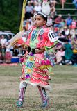 Young Powwow Jingle Dress Dancer. Ohsweken, Ontario, Canada, July 27, 2008. A young Jingle Dress Dancer performs during the Grand River Champion of Champions stock photo