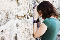 Young prayer against wall Stock Photo