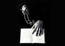 Young praying hands with wooden rosary and Holy Bible. Religion concept black and white photo Stock Photography