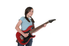 Young Pre Teen Girl Playing Guitar 1. Young pre teen girl playing a red electric guitar royalty free stock image