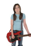 Young Pre Teen Girl Playing Guitar 2. Young pre teen girl playing a red electric guitar stock image