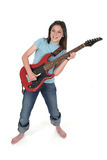 Young Pre Teen Girl Playing Guitar 3. Young pre teen girl playing a red electric guitar royalty free stock images