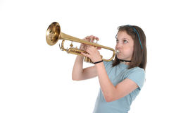 Young Pre Teen Girl Playing Trumpet 1. Young pre teen girl playing a trumpet Royalty Free Stock Photo