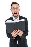 Young preacher reading from bible Royalty Free Stock Photos