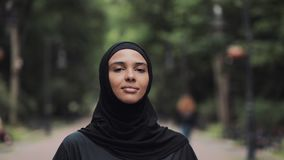 Young Preety Muslin Girl Wearing a Hijabt Running in the Park Concept Healthy Lifestyle Close Up. Young Preety Muslin Girl Wearing a Hijabt Running in the Park stock footage