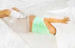 Young pregnanat woman in the bed with face under pillow Royalty Free Stock Photo